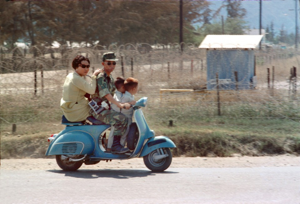 People riding motorcycles on the streets in Nha Trang, Vietnam in 1969